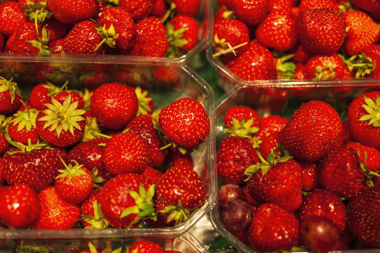strawberries in transparent plastic boxes