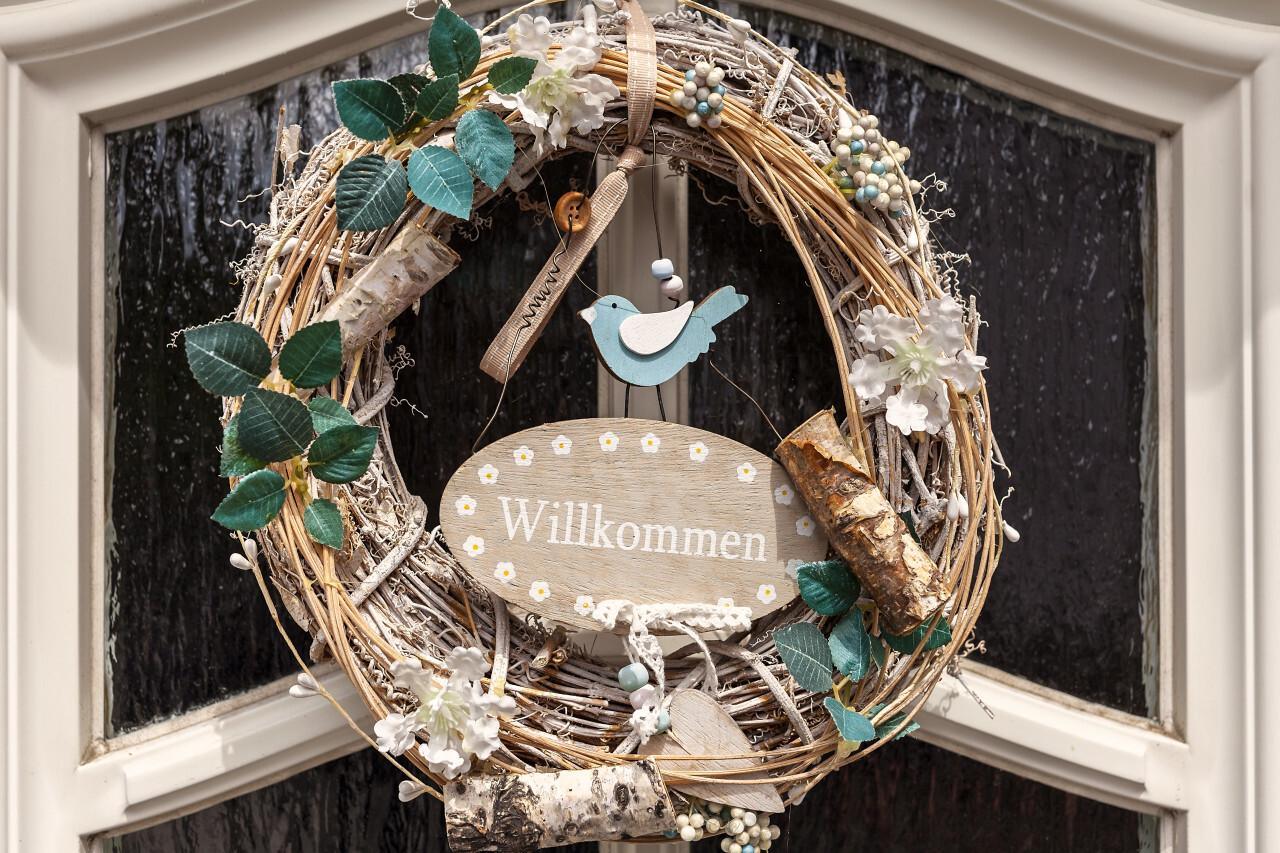 door wreath in germany willkommen means welcome