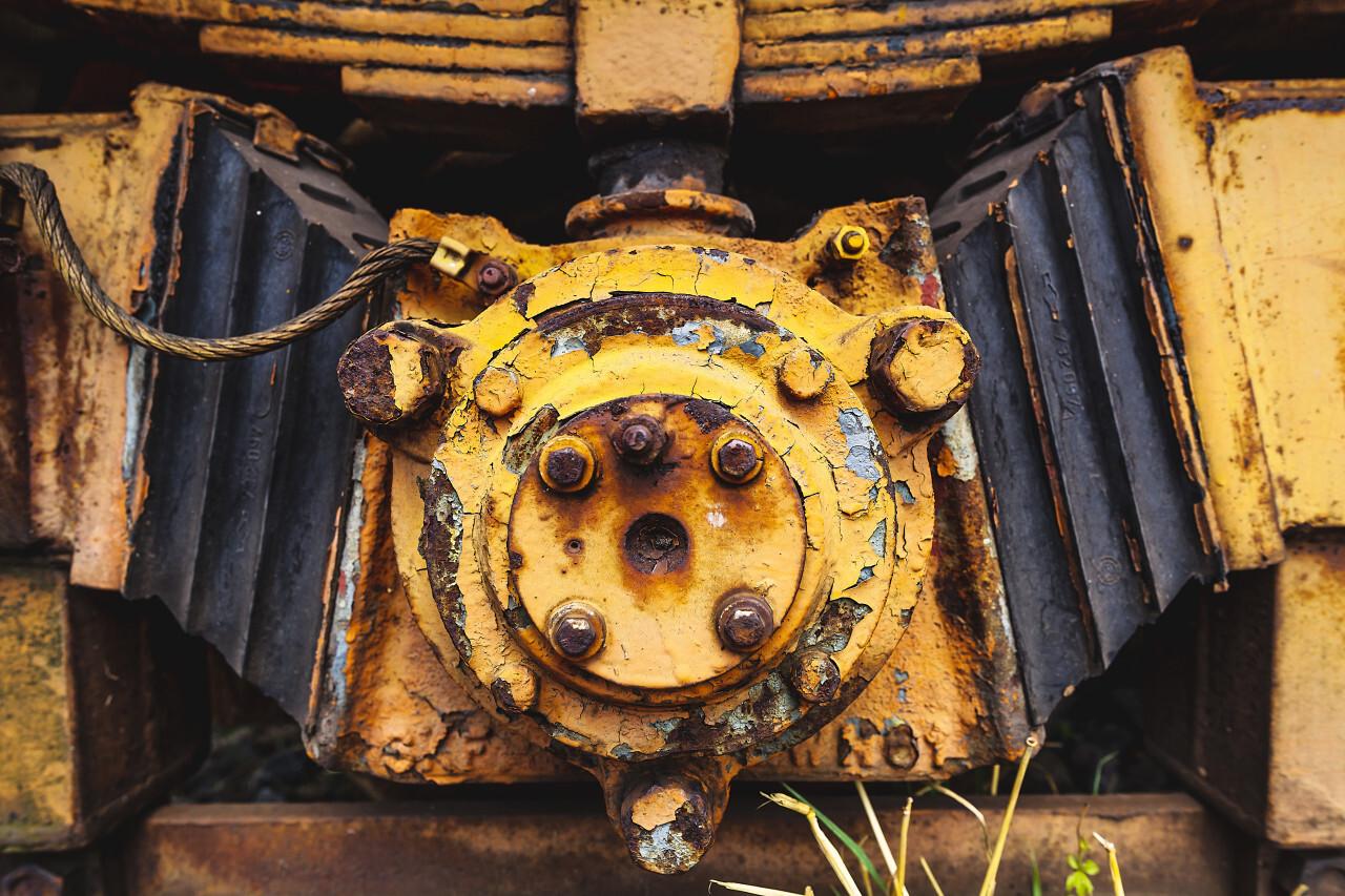 grunge yellow metal tram wheels