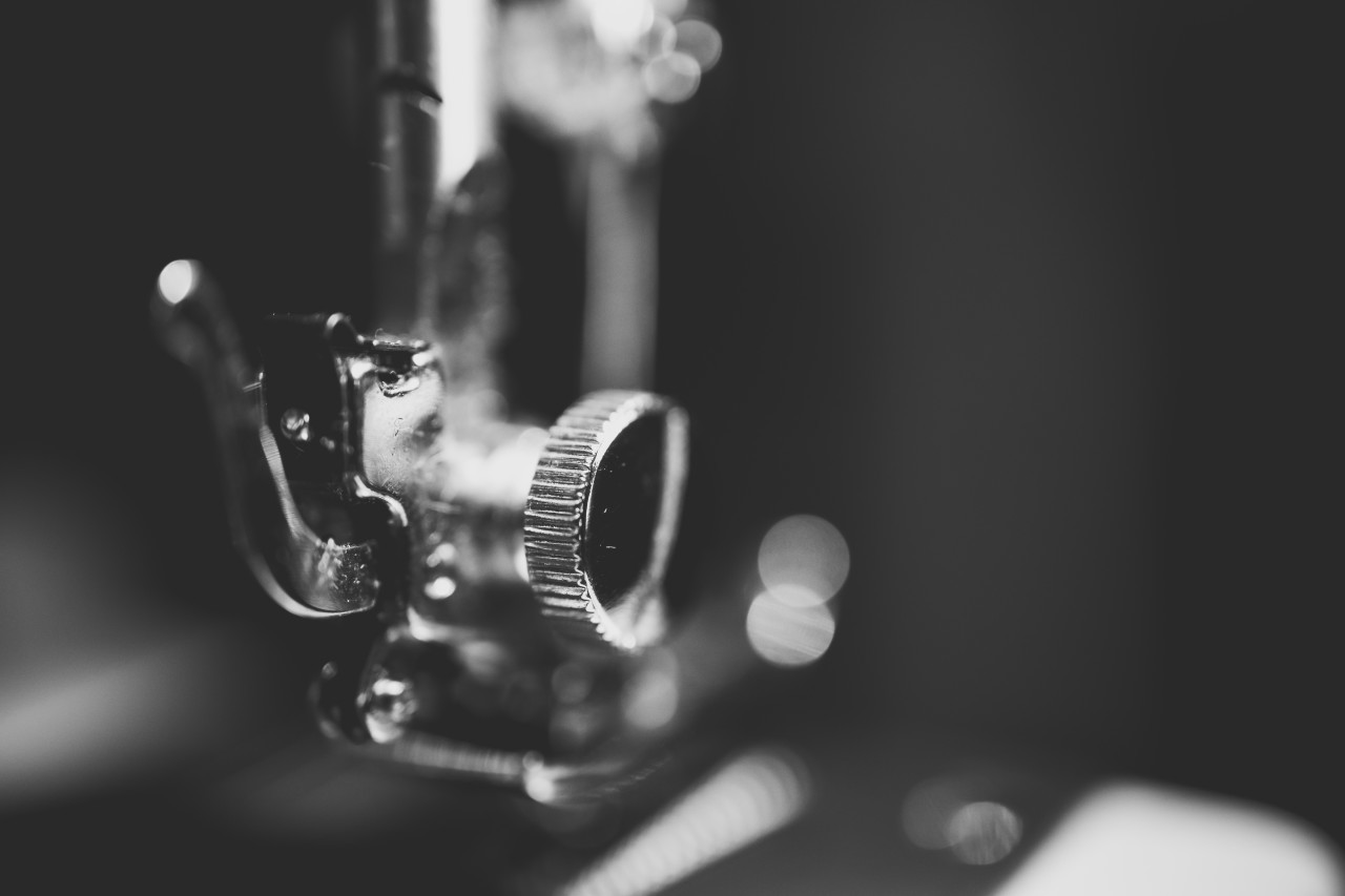 sewing machine needle head black and white