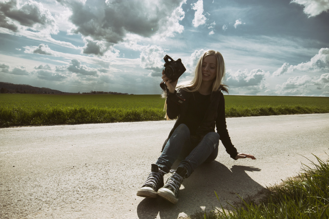 young girl with camera - female photographer