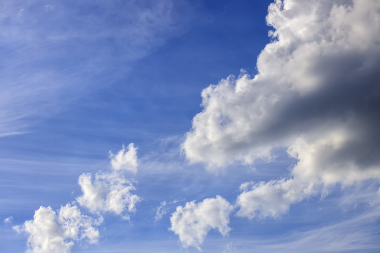 Bright beautiful blue sky with soft clouds, bright sunny day