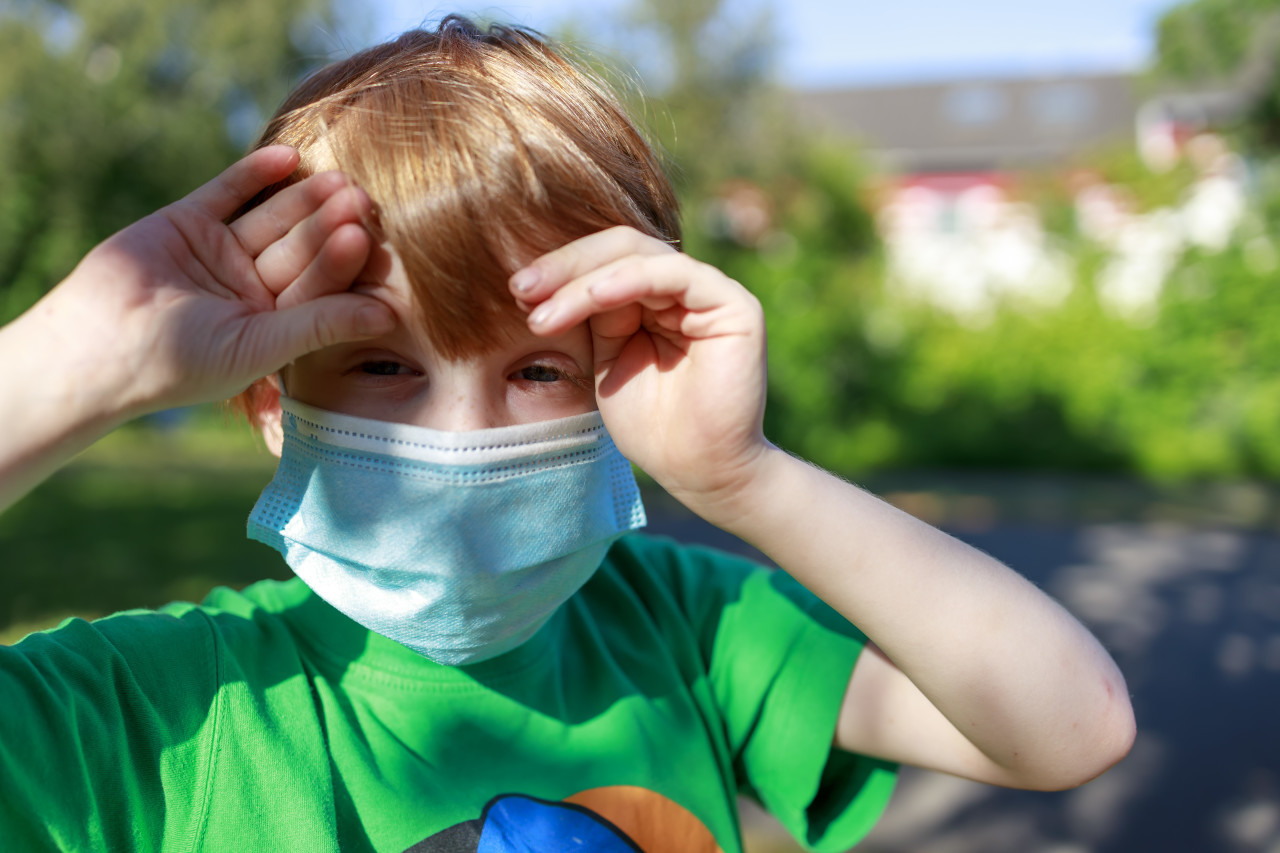 young boy with a mask - protection against covid-19 coronavirus