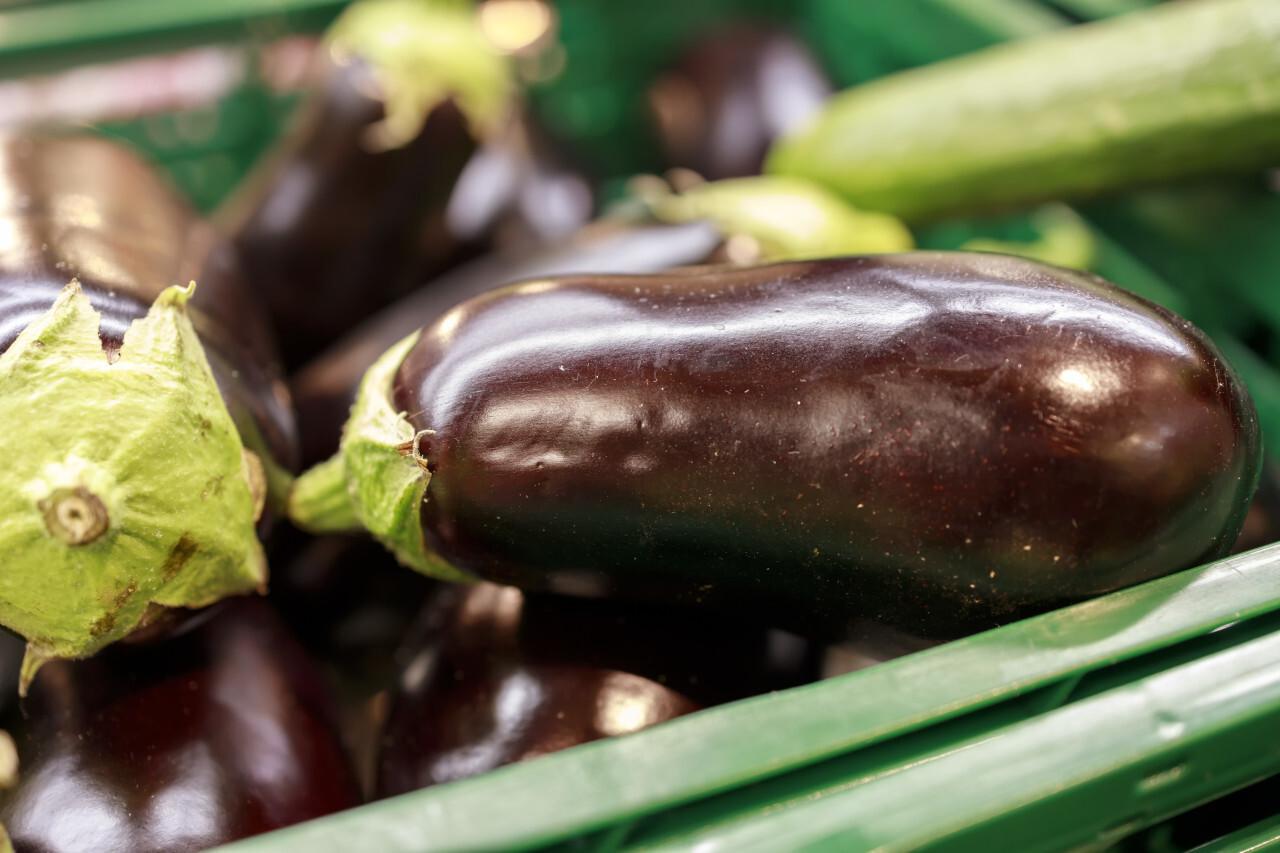 Eggplants at a market stall