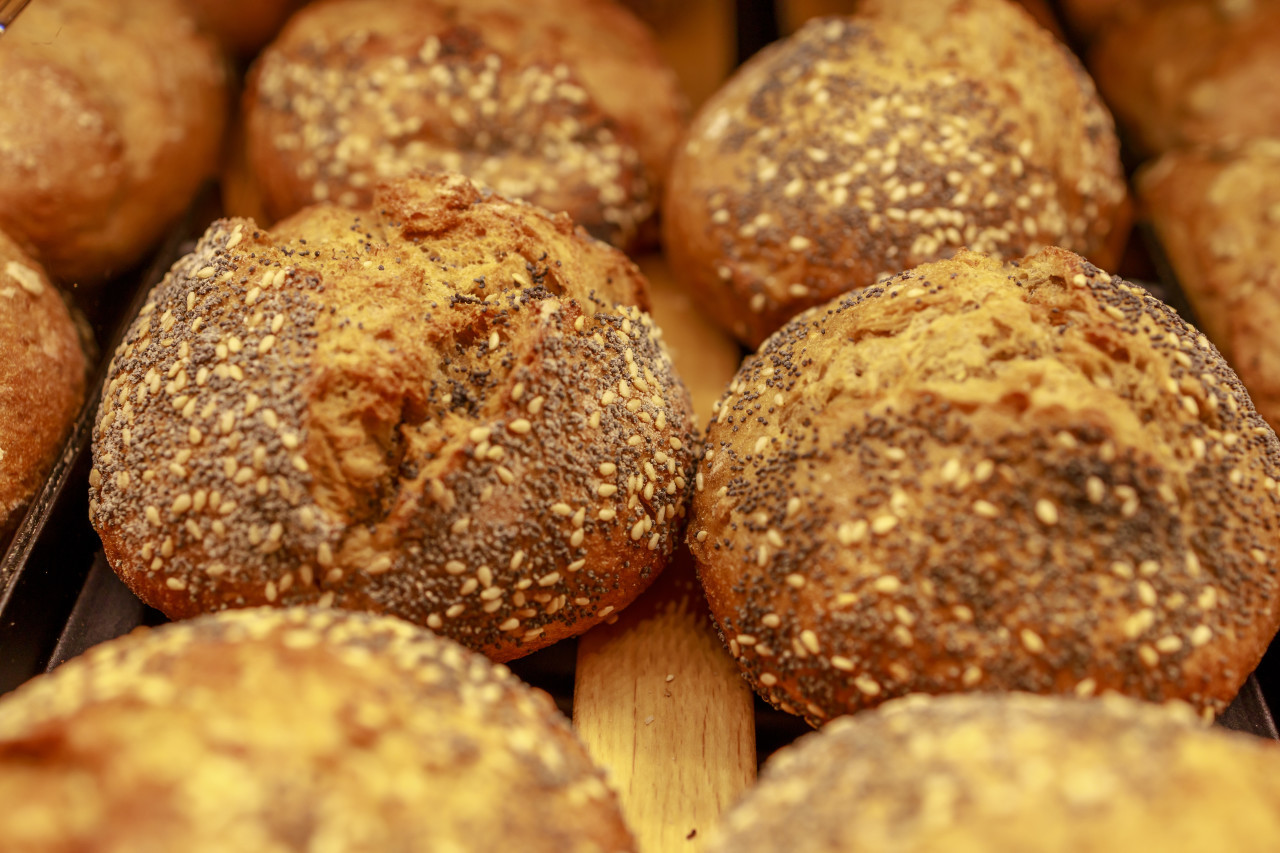 Fresh bread rolls in the bakery with grains