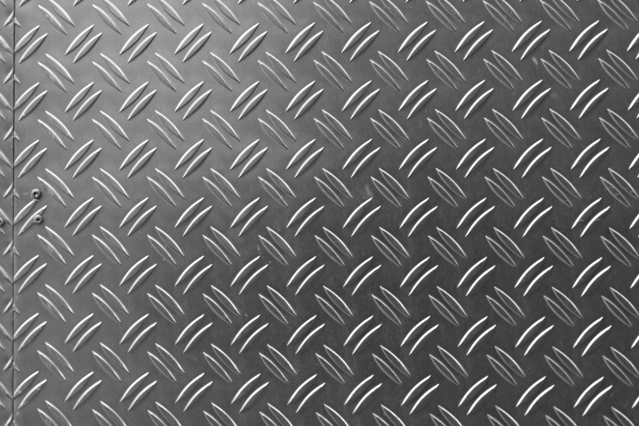 Metal texture background aluminum brushed silver. Metal floor plate with diamond pattern.