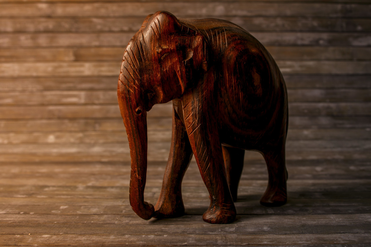 Carved wood elephant figure