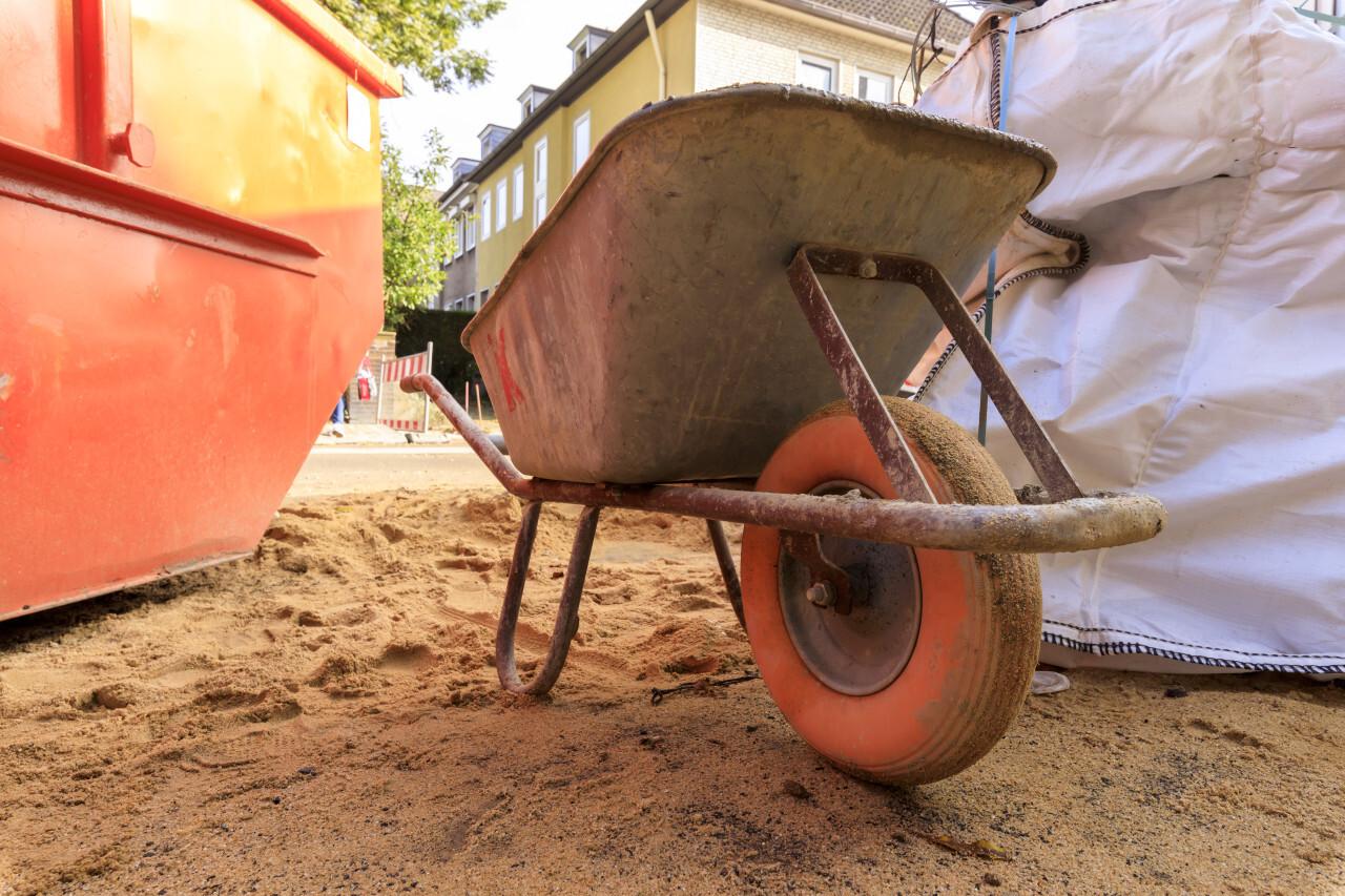 Old wheelbarrow on a construction site
