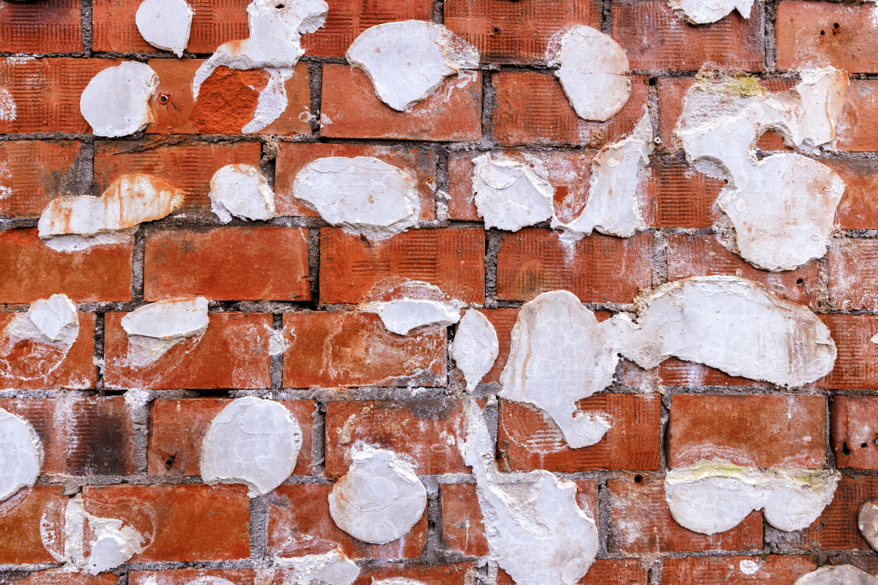 Weathered stained old grunge brick wall texture background