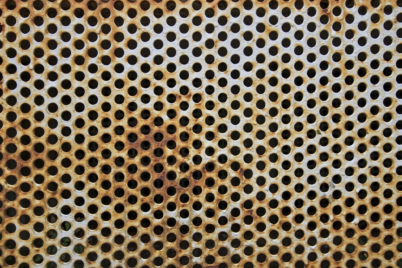 Grunge Metal perforated texture background
