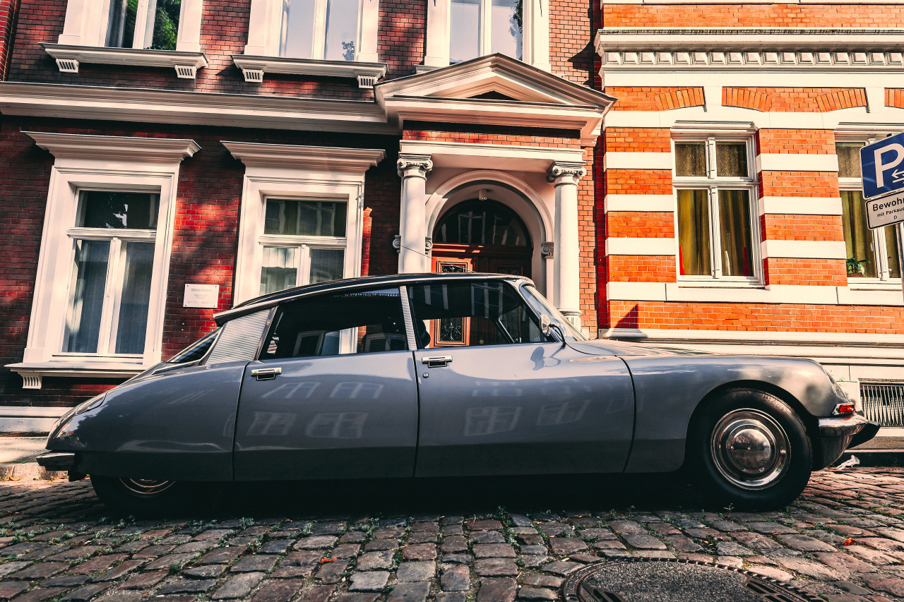 Lübeck, Schleswig-Holstein, Germany - JULY 28, 2019: beautiful old classic car in the medieval old town
