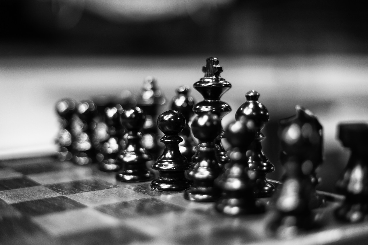 chessboard with black chess figures