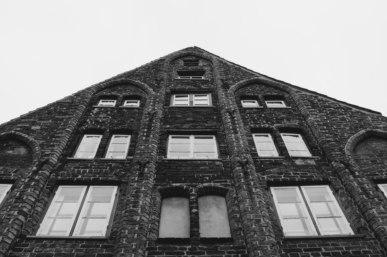 old brick house in lubeck black and white