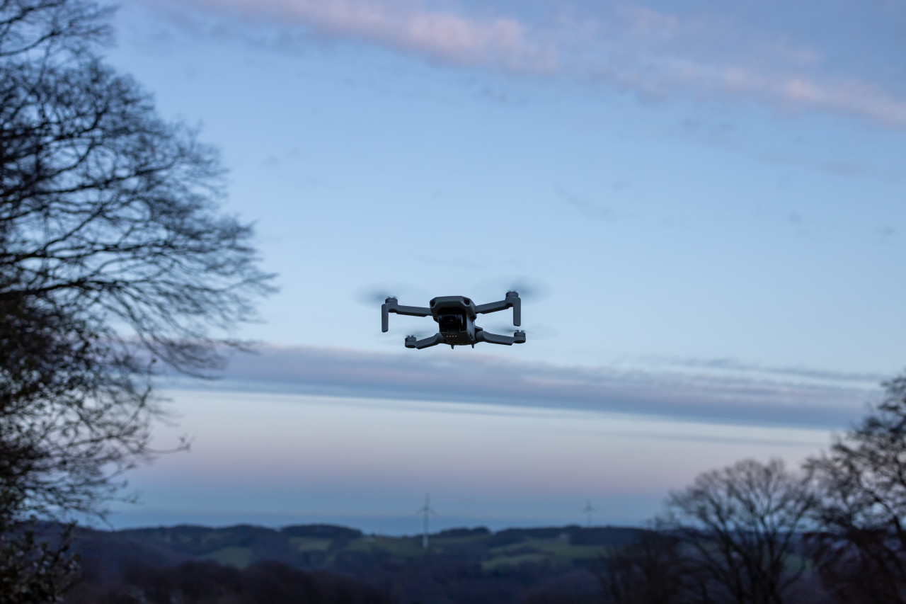 Quadrocopter drone flying in the sky