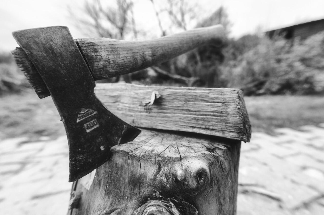 Ax stuck in block of wood