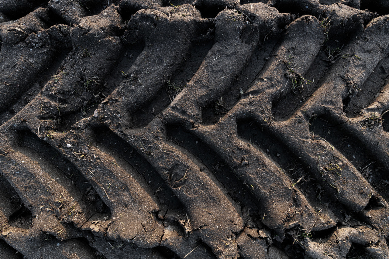 Tractor tracks in the mud texture