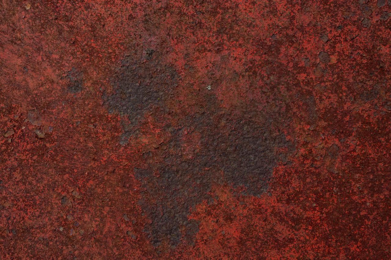 Grunge weathered red metal texture