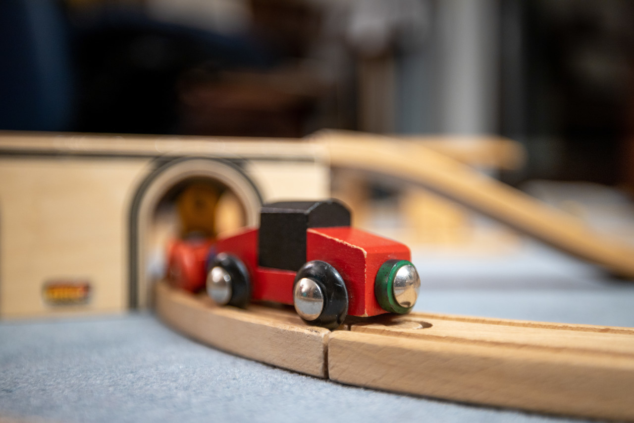 Wooden train with wooden tracks in the children's room
