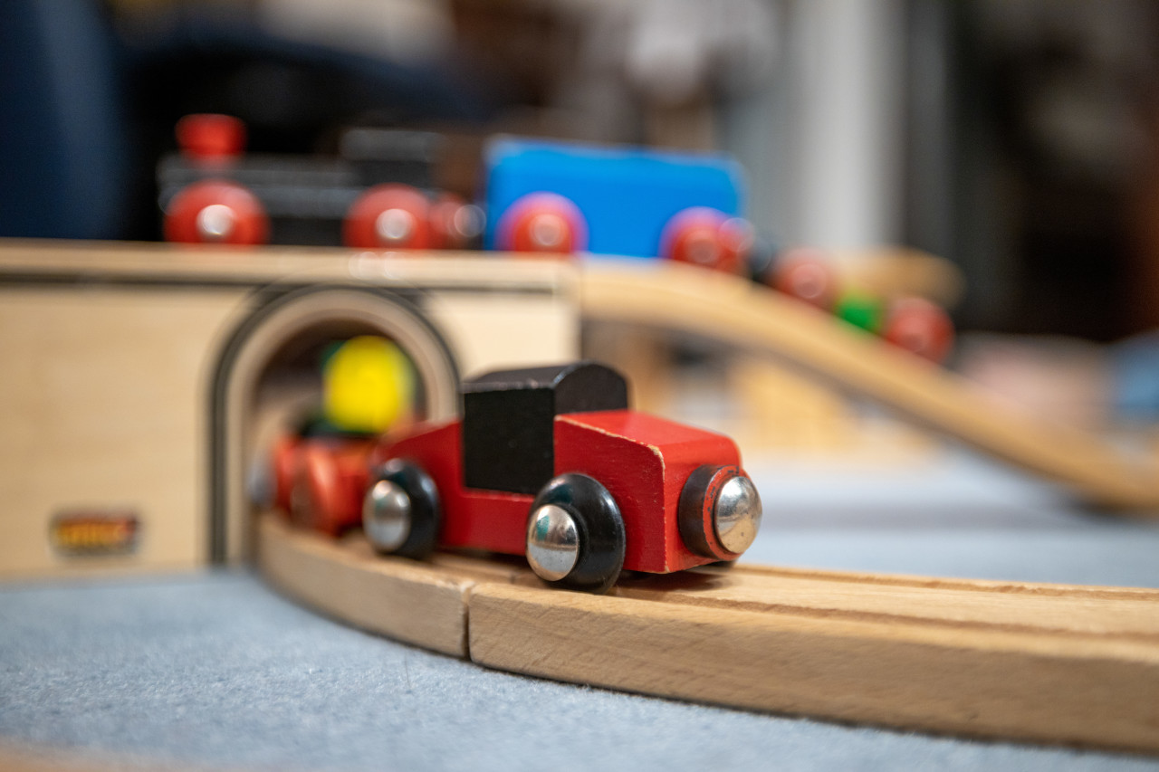 Red wooden train in the nursery
