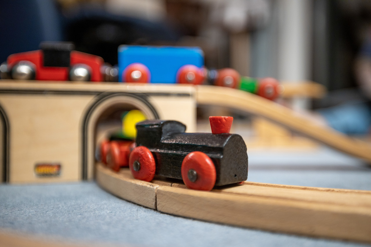Black wooden train in a child's room