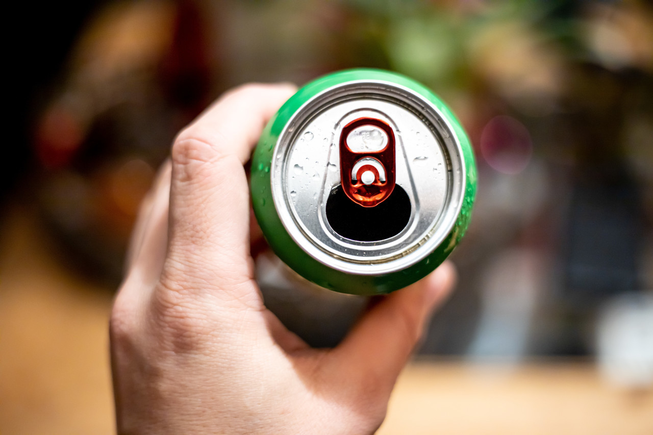Soft Drink Can in a Hand
