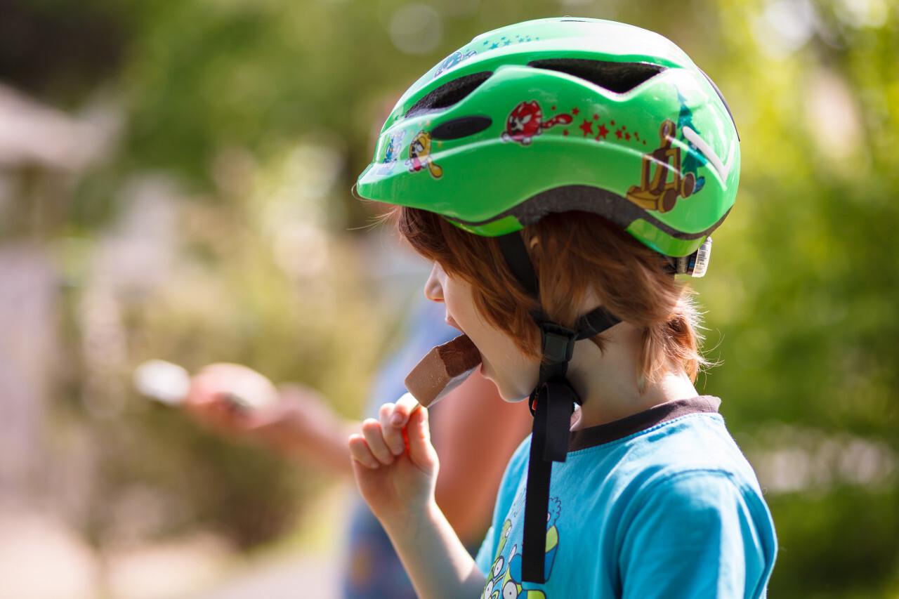 Little boy eats chocolate ice cream
