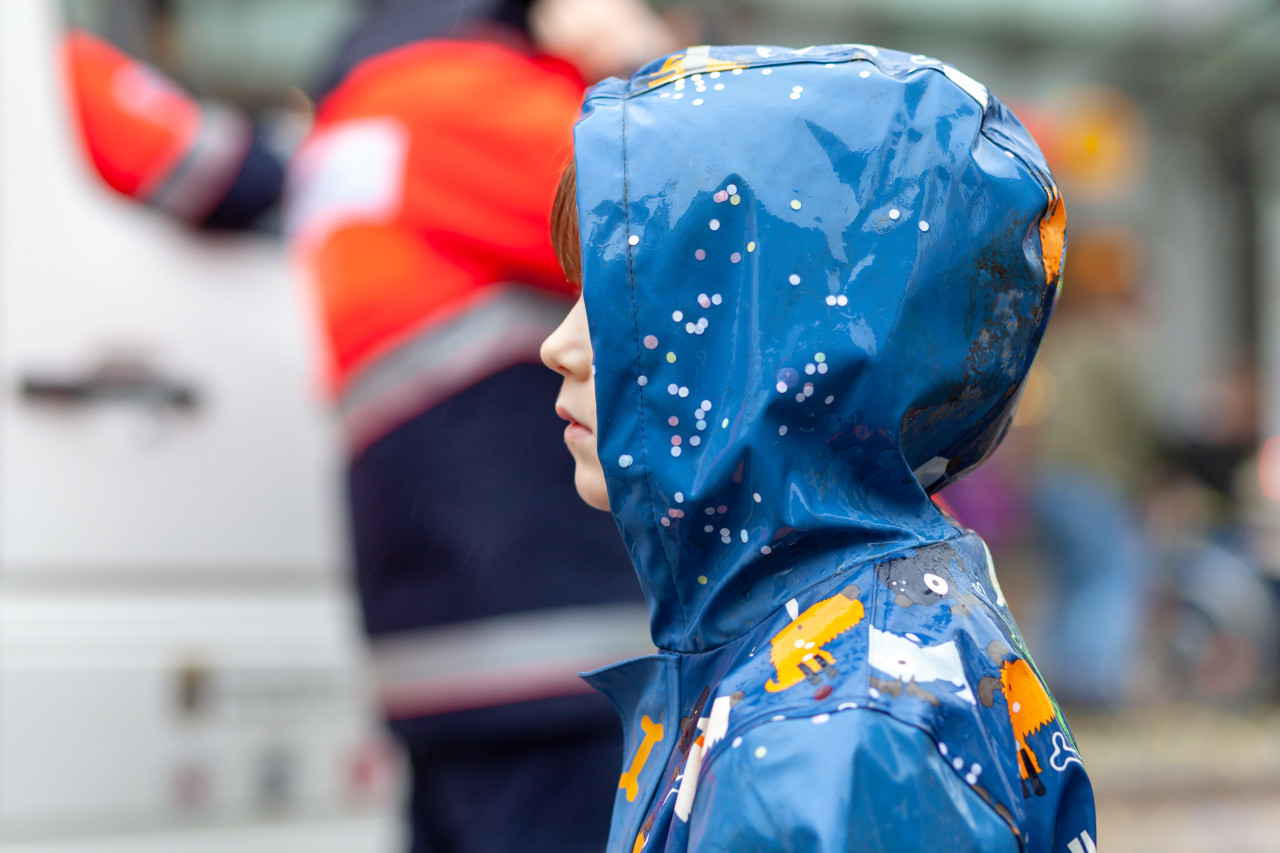 Child stands in the rain