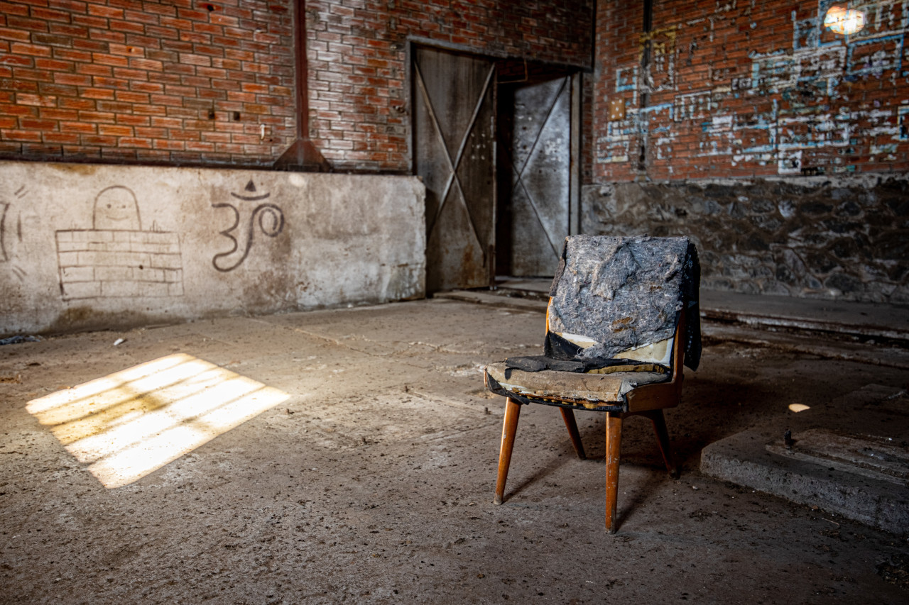 rotten chair in a lost place