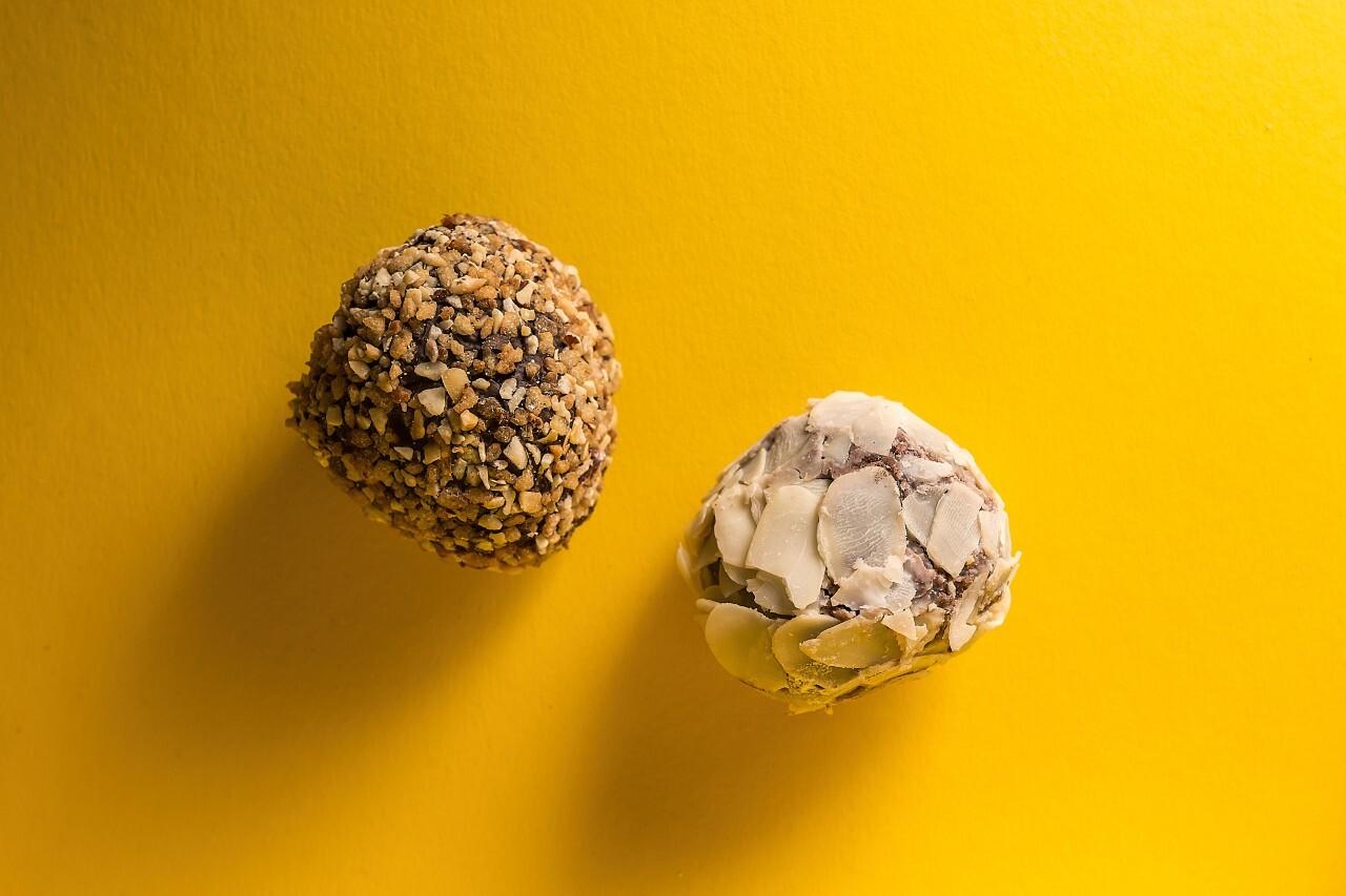 hazelnut and almond pralines on yellow background