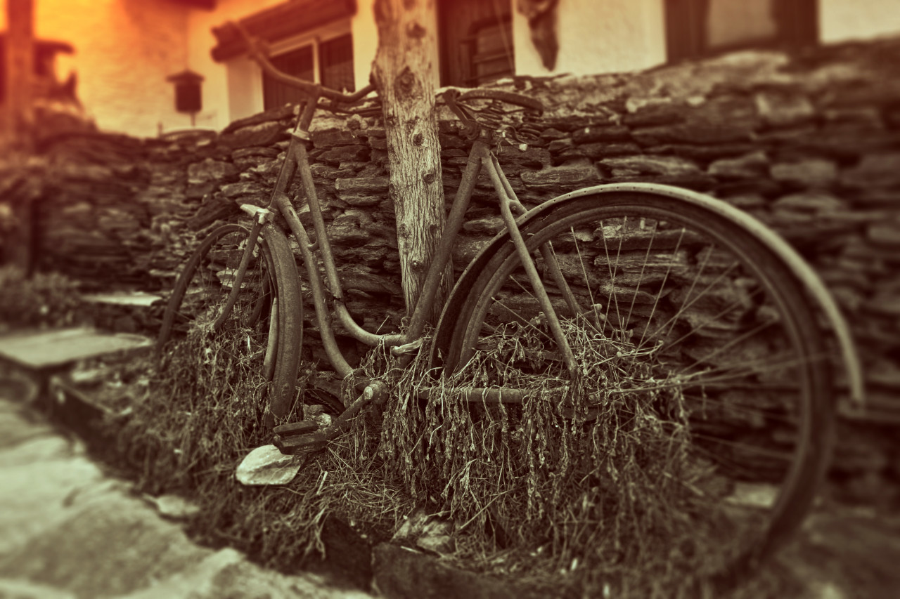 Old bike on the side of the road