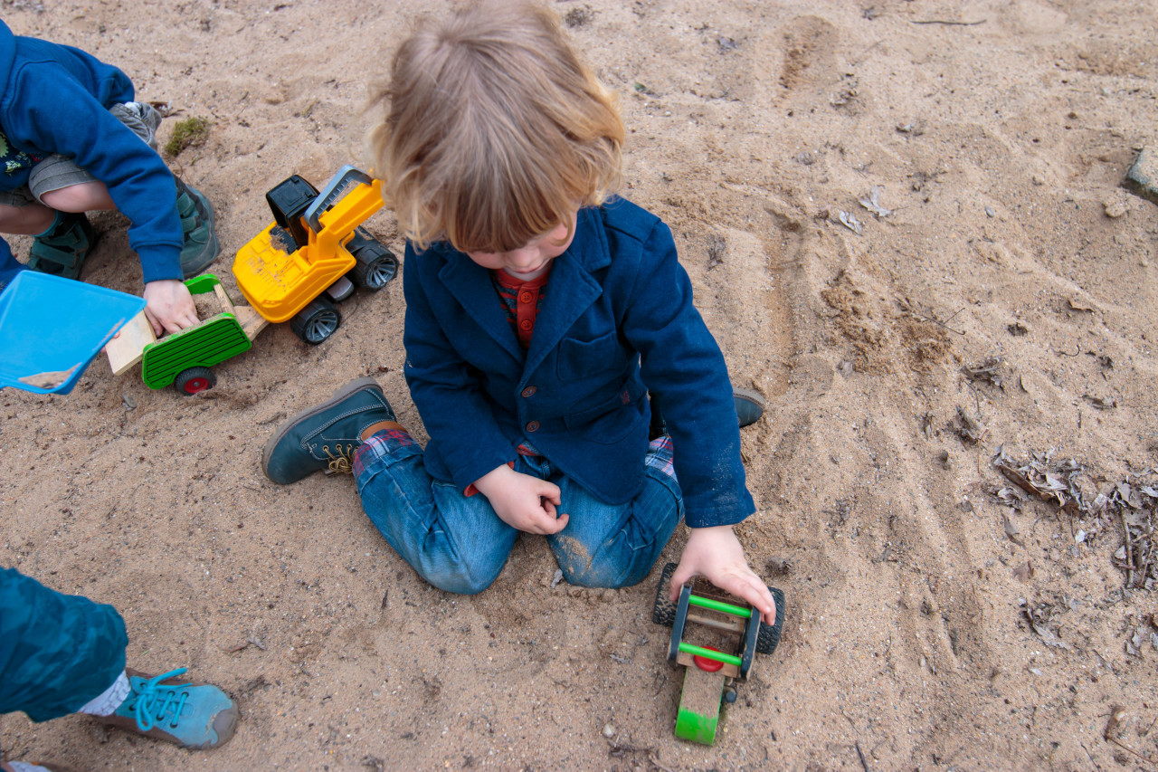 Boy plays in sandpit