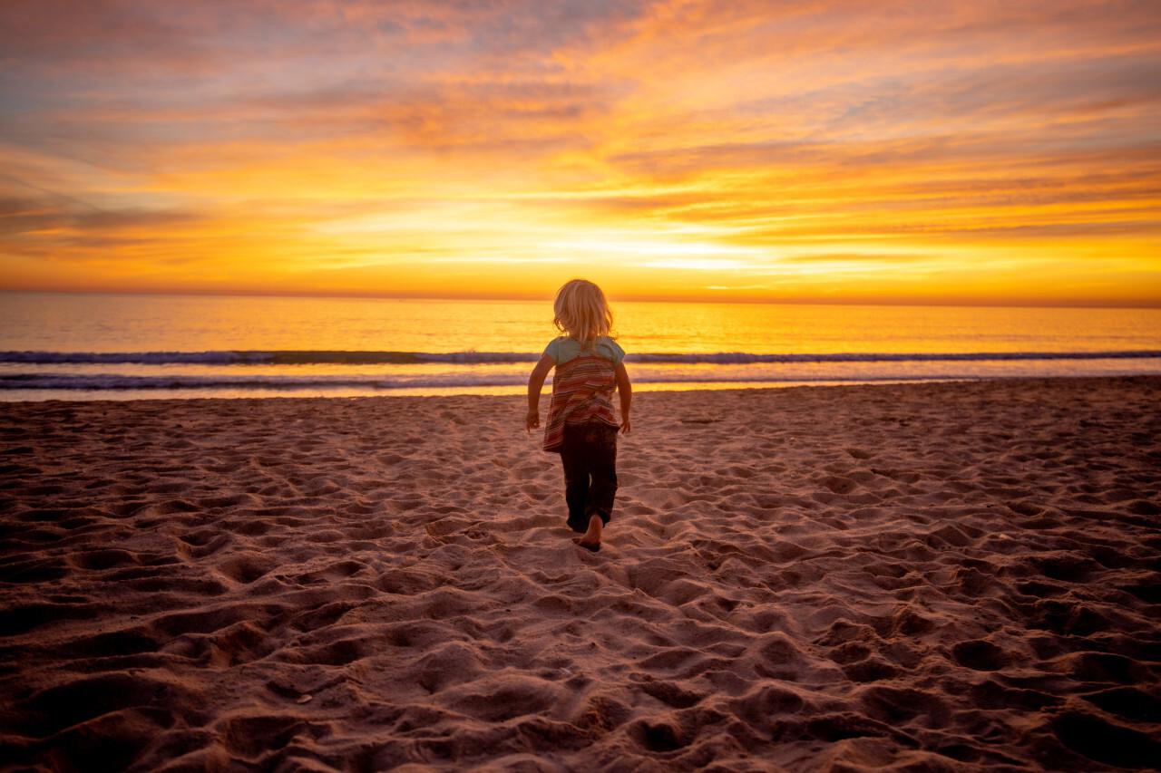 Little blonde girl on the beach at sunset - Portugal Algarve