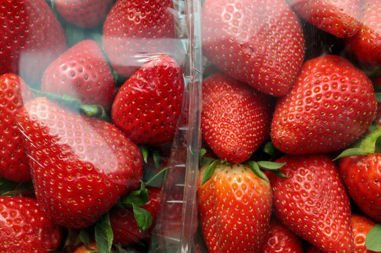 Strawberries in transparent plastic packaging