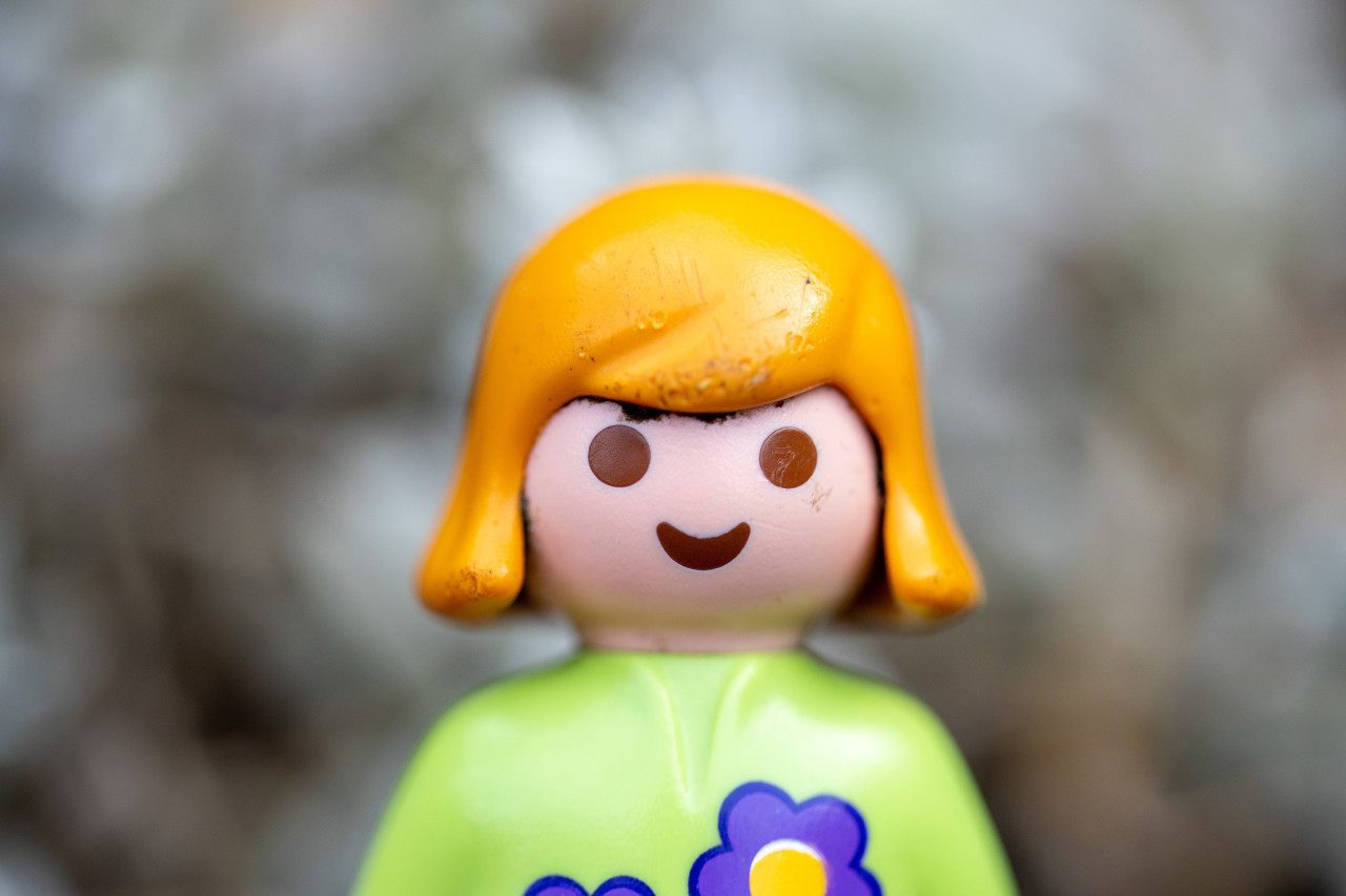 Smiling girl toy figure portrait