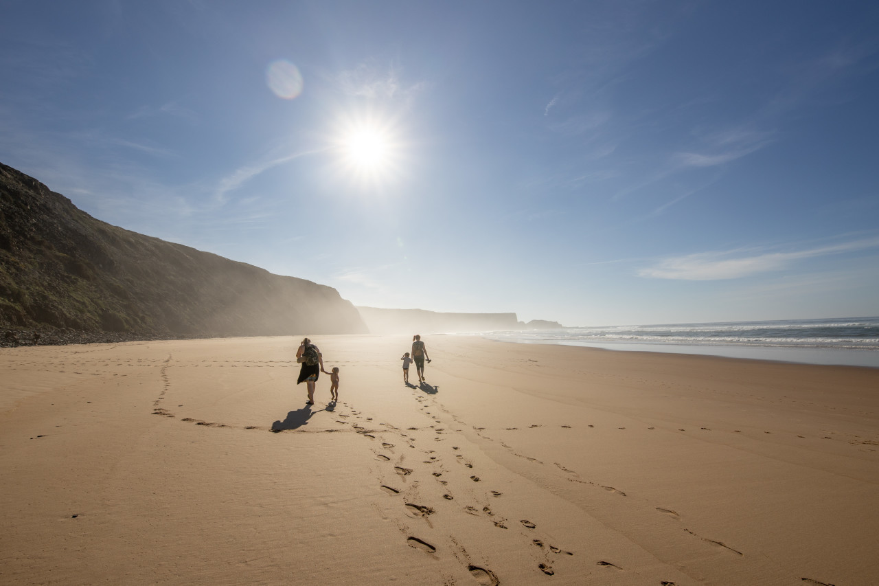 Family walks on the beach in Portugal