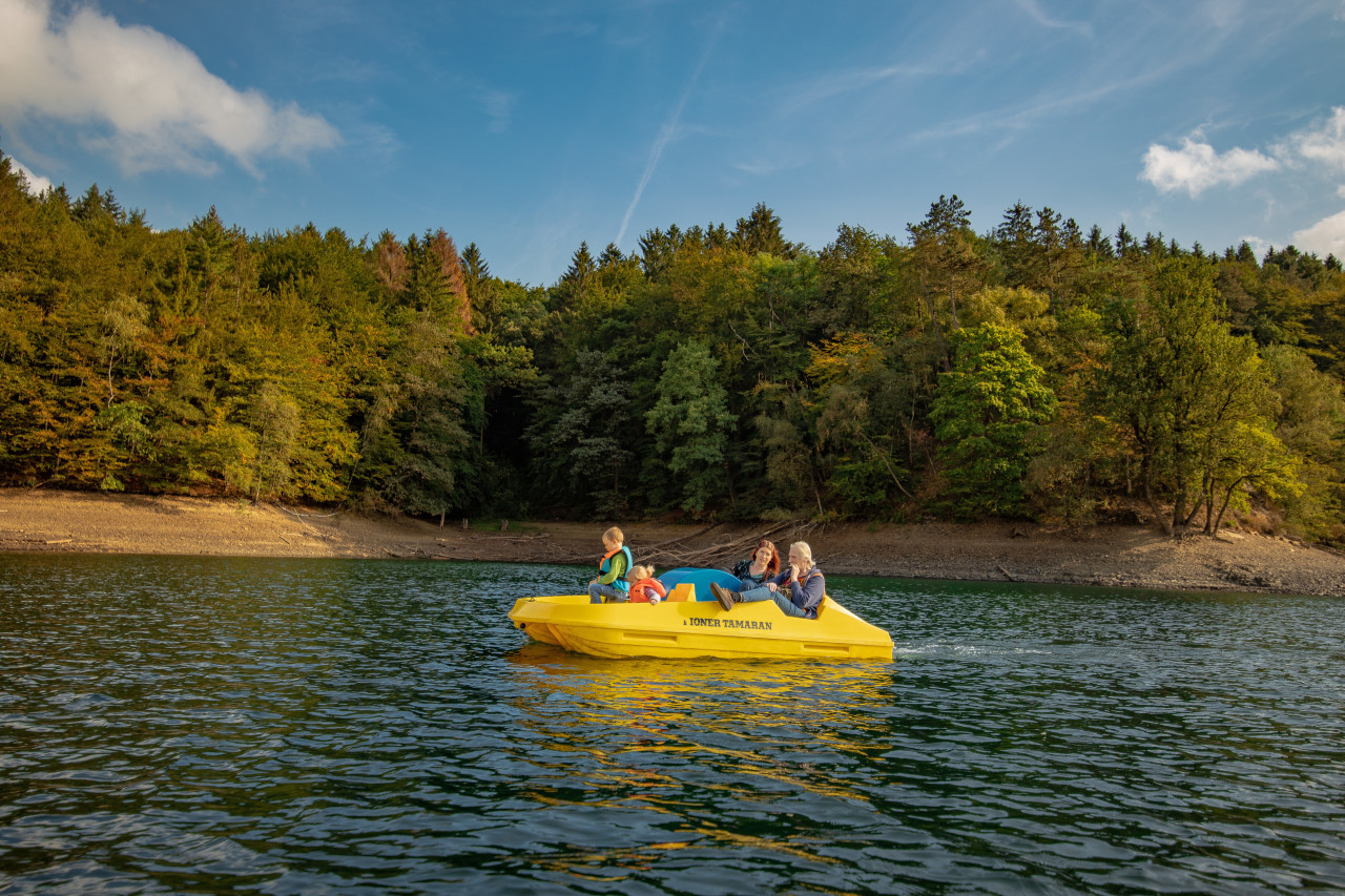 Family in yellow boat on a lake