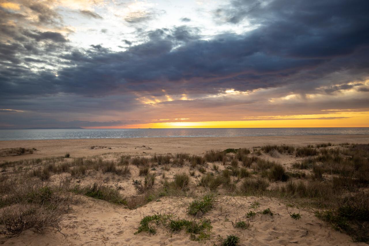 Romantic sunset in tarifa on the beach