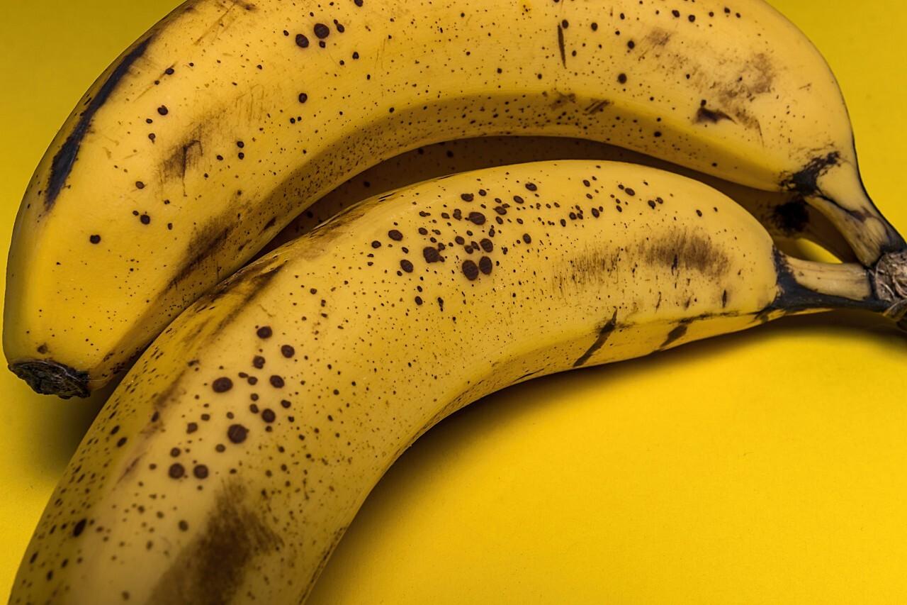 ripe bananas yellow background