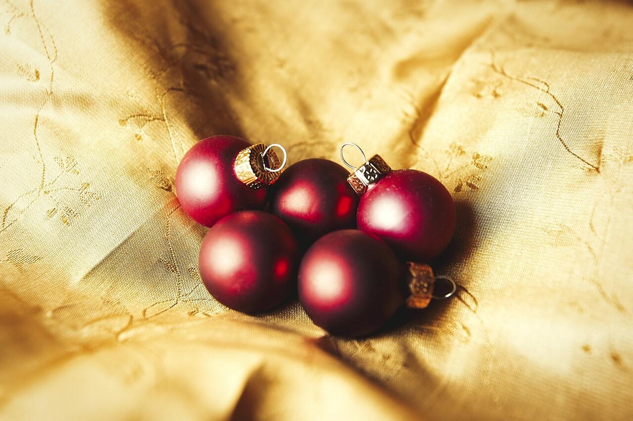 christmas balls on golden velvet