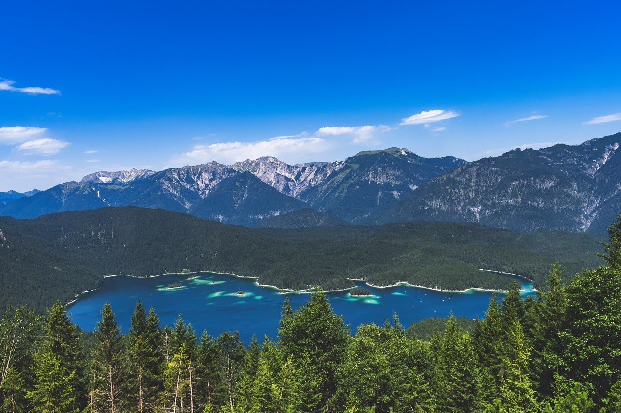 Alpine landscape with the Eibsee lake against mountains