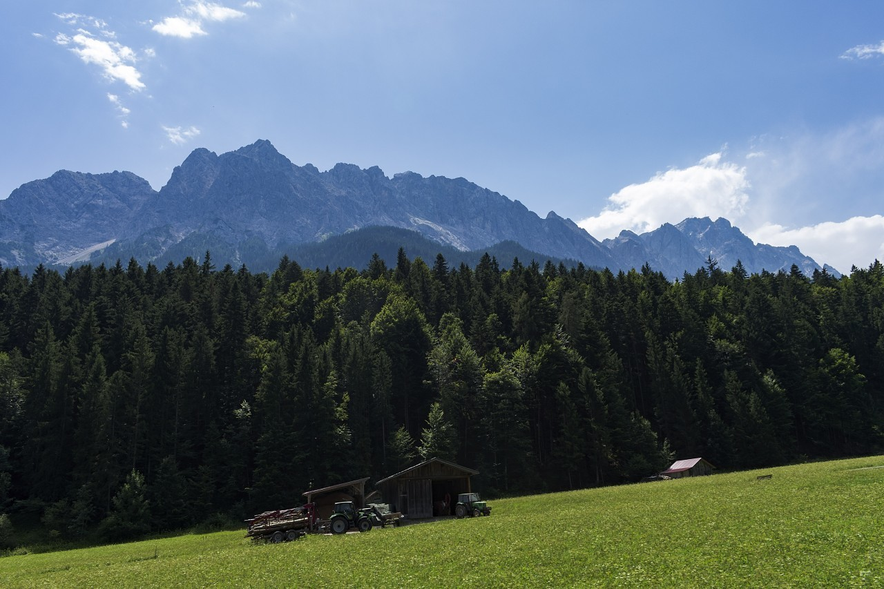 Idyllic mountain landscape in the Alps with traditional mountain lodge