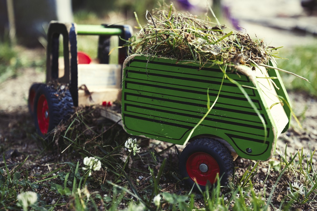 toy tractor loaded with grass