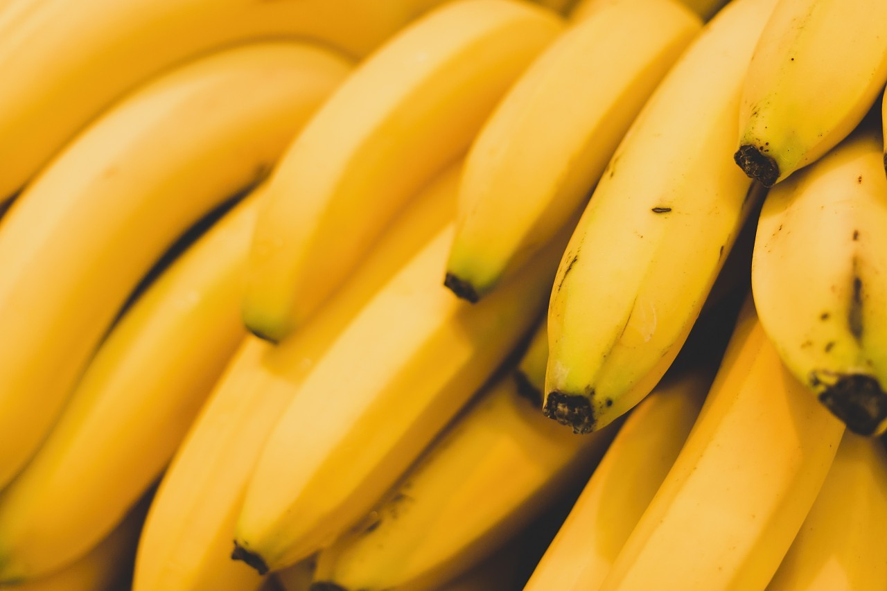 beautiful yellow bananas from the market background