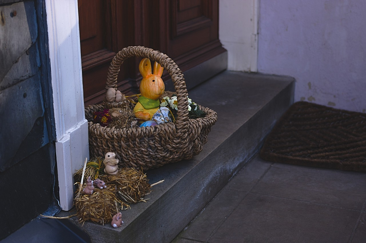 Basket filled with Easter decorations on a doorstep