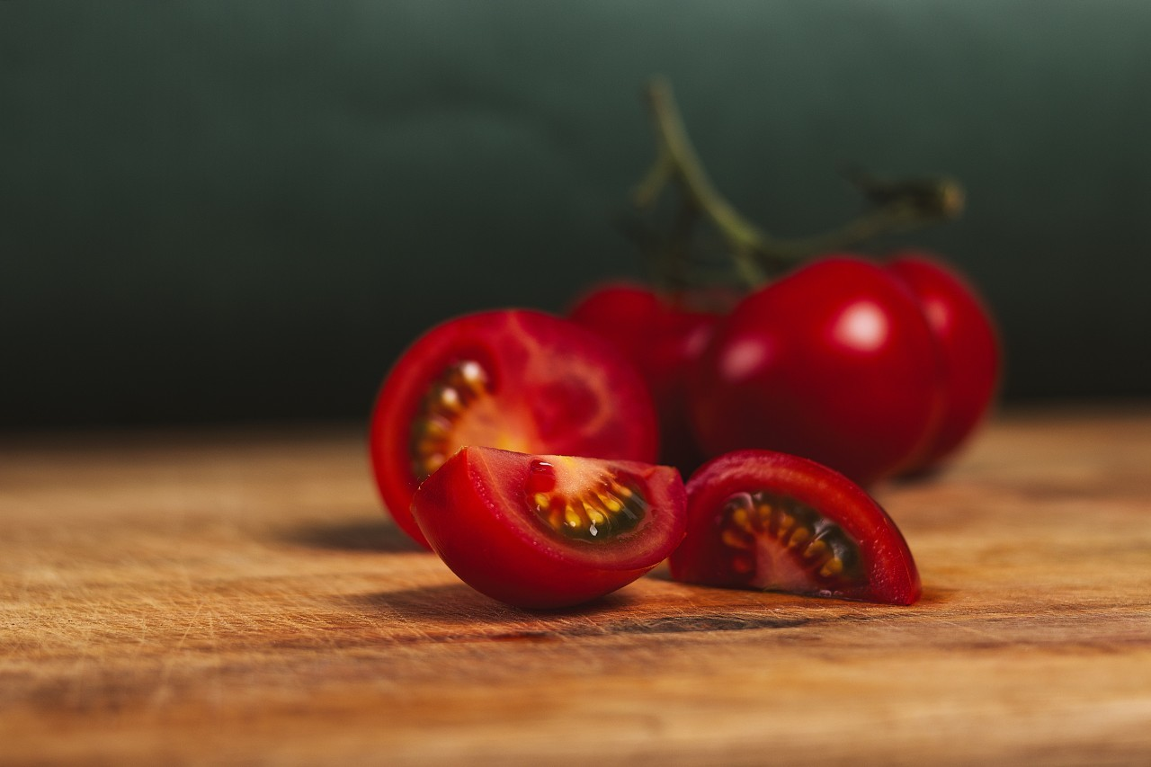 tomatoes sliced on a wooden board
