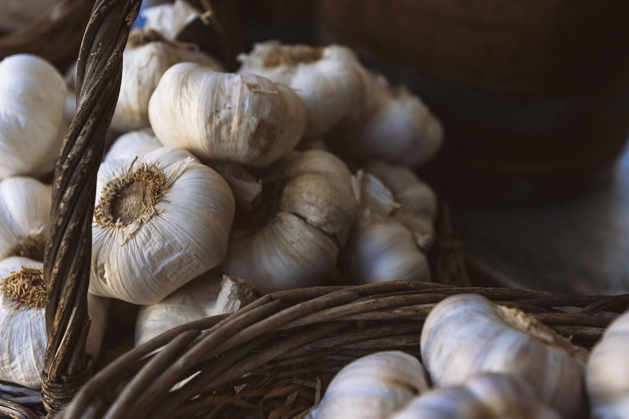 garlic cloves in baskets
