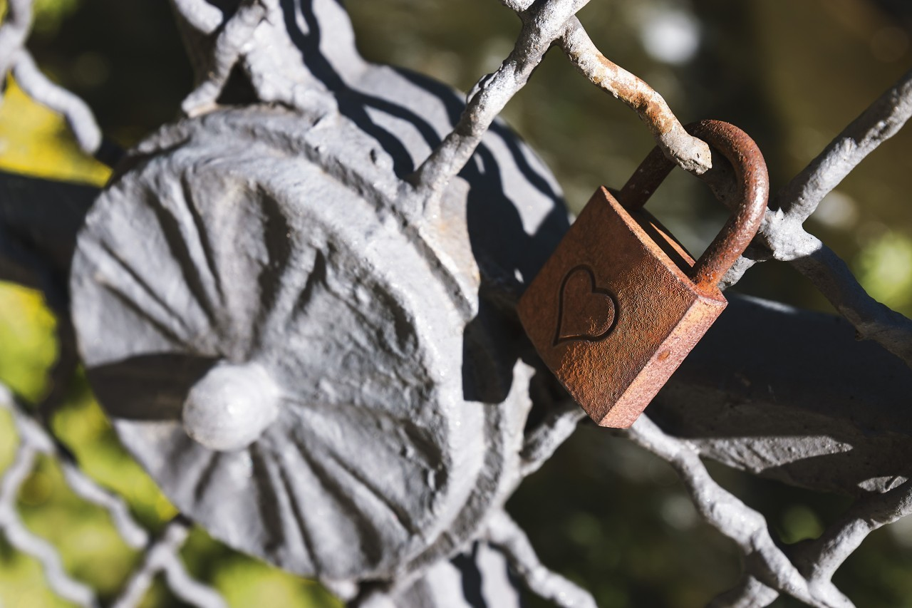 old rusty love padlock with heart