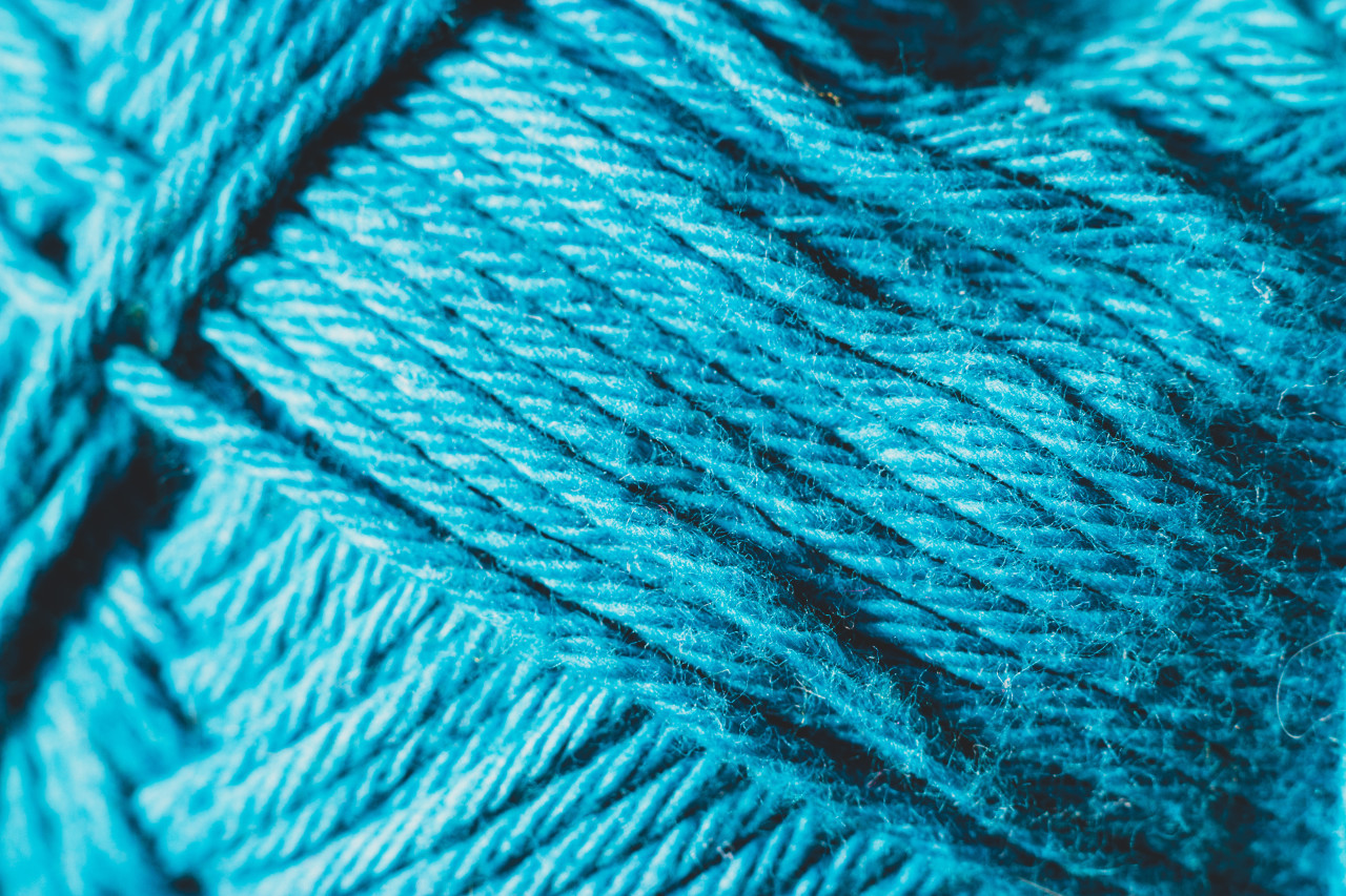 Close up the blue yarn background