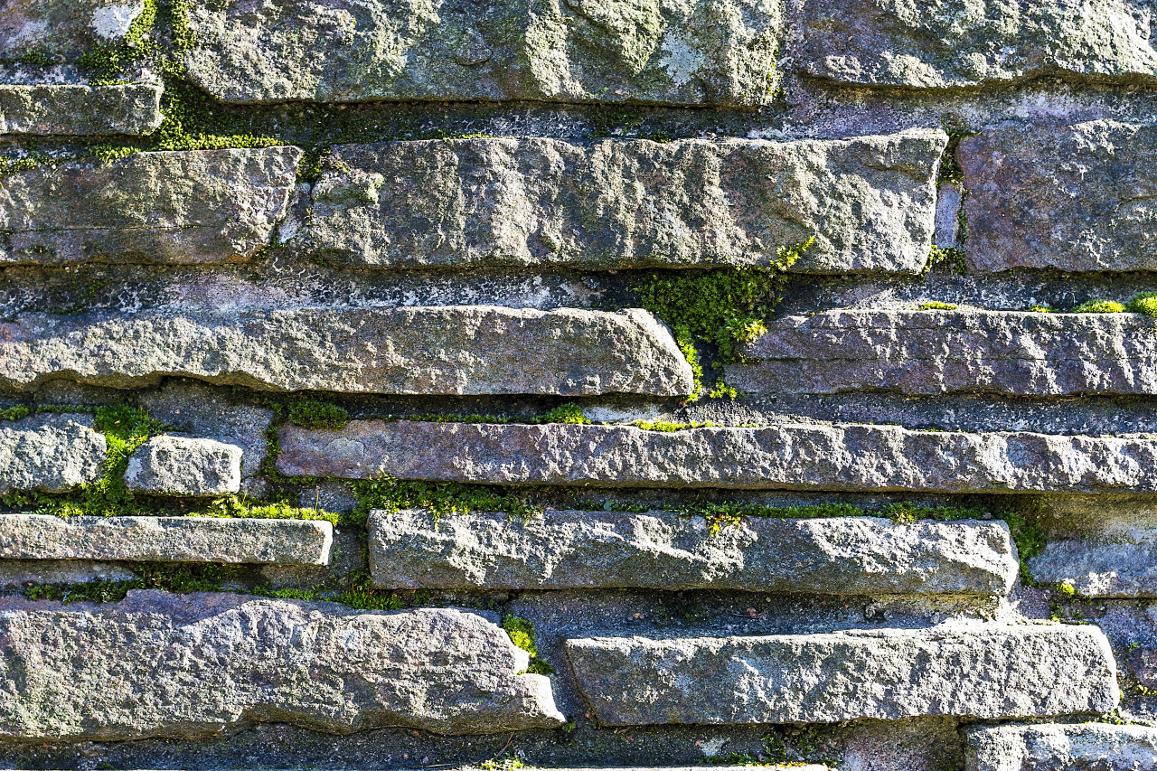 stone wall texture covered with moss