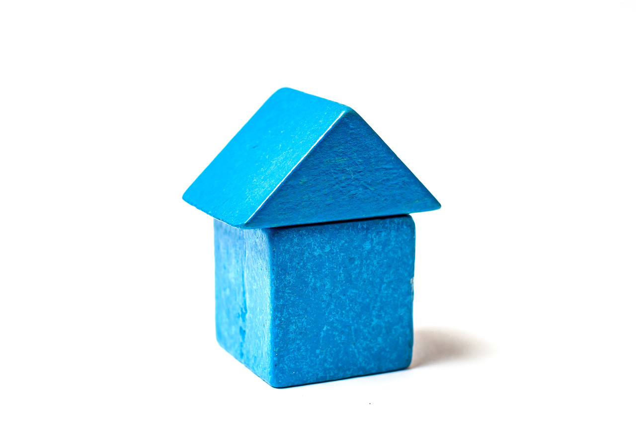 blue toy block house white background